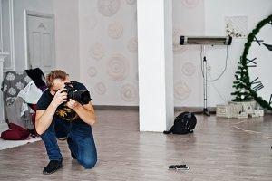 Photographer shooting on studio. Pro