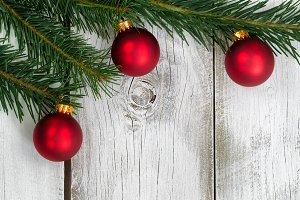 Three Red Ornaments on Grand Fir