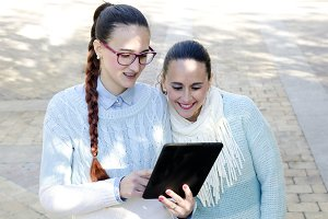 Two women using a tablet