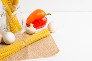 Pasta ingredients on white