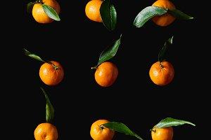 tasty orange tangerines with green l