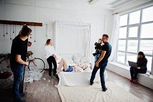 Work process of team photographer, d