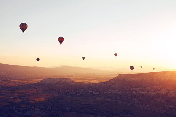 Holiday Stock Photos - Hot air balloons over the valley
