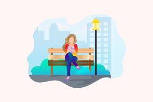 Woman Reading Book at City Park