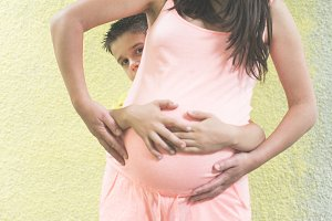 Pregnant women and small boy