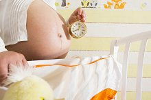 Pregnant women in a baby room