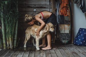 girl washes the dog