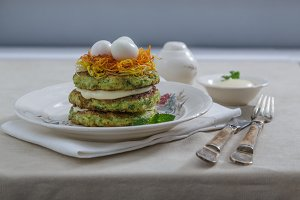 Courgette pancakes with eggs and