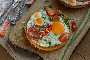 Sunny side fried eggs with tomato