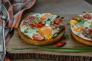 Fried eggs and tomato toasts on