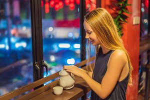 A young woman drinks Chinese tea on