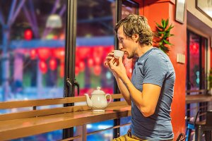 A young man drinks Chinese tea on a