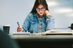 Woman student studying at college
