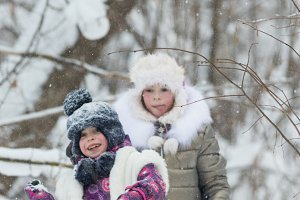 Winter forest. Two little girls