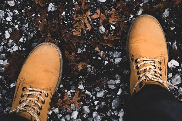 Feet of traveler in boots standing