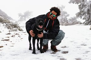 Man with dog in snow