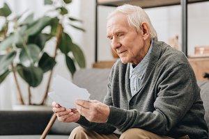 happy pensioner with grey hair looki