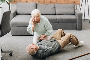 senior woman helping to husband who