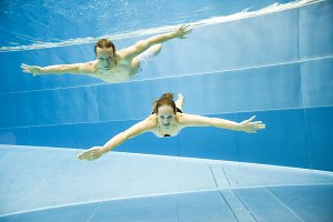 Underwater View Of A Young Couple