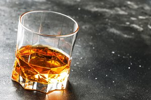 One glass of golden scotch whiskey o