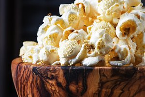 Salted popcorn in a wooden bowl, unh