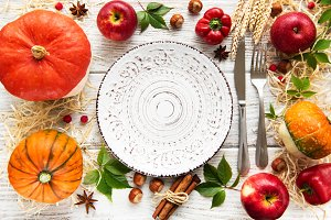 Empty plate and  colorful autumn pum