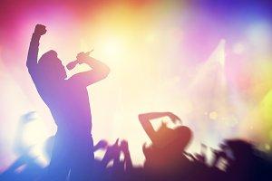 Singer singing on stage on a concert