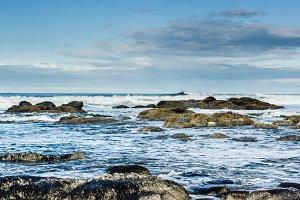 Rocky ocean beach with surf