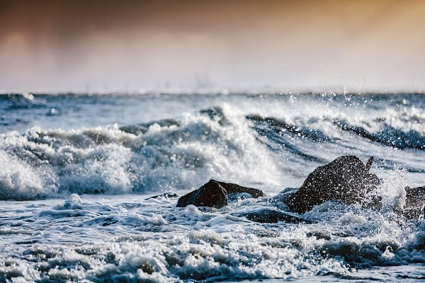 Storm on the sea, waves hitting roc…