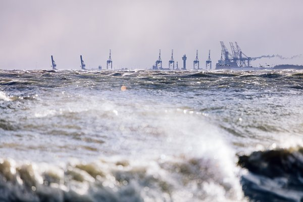 Stormy sea and industrial landscape