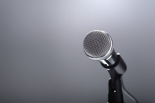 Microphone on grey background.