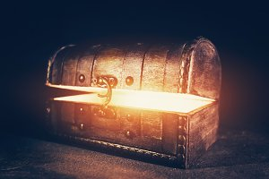 Magic wooden box with glowing light.