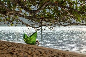 Cuddling couple in swinging hammock