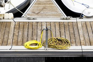 wather hoses in wooden pier
