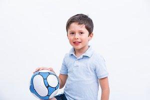 Happy boy playing football