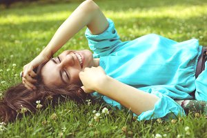 Smiling Girl On The Lawn