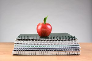 Spiral Notebooks and Red Apple