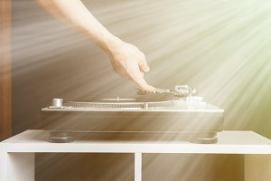male hands use turntable. music love