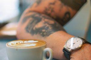tattooed guy in the coffee shop
