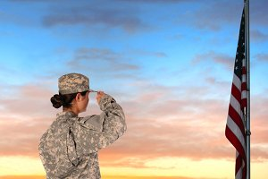 Female Soldier Saluting Flag Sunset
