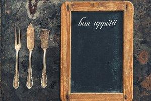 Vintage silver cutlery & blackboard
