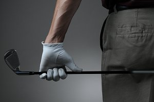 Closeup of Golfer with Club Behind