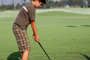 Young Golfer at Practice Range