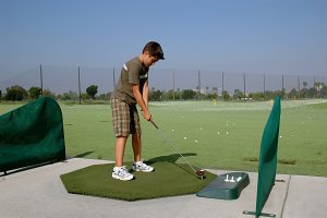 Youth Golfer at Range