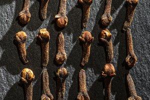 Dried Cloves on dark stone backgroun