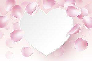 Rose petals falling and paper heart