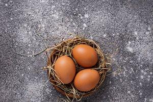 Fresh raw brown eggs in bowl.