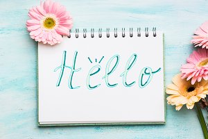 Hello word written on notebook page