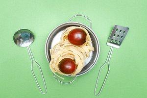 Dry pasta  tagliatelle  and cherry