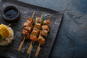 Salmon skewers with miso close view